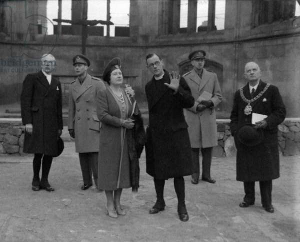 King George VI and Queen Elizabeth inspecting the ruins of Coventry Cathedral, accompanied by the Bishop of Coventry, Mervyn George Haigh, the Provost and the Mayor, 25th February 1942 (b/w photo)