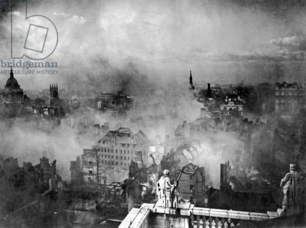 View of the City of London taken from the roof of St. Paul's Cathedral showing the devastation and burning buildings following the Blitz of the 29th December 1940 (b/w photo)