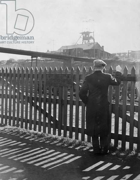 A miner looks over the fence toward the Gorkie Colliery during the miners strike in World War Two, 10th March 1944 (b/w photo)
