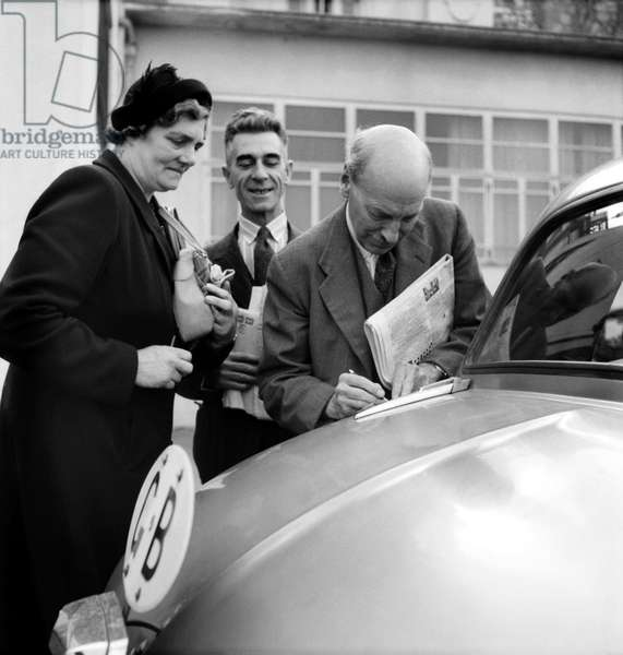 Clement Attlee signs autograph at the Labour Party Conference, 1953 (b/w photo)