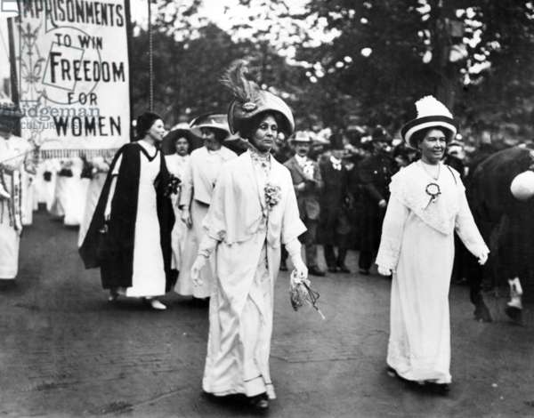 Lady Pethick-Lawrence (right) and Mrs Pankhurst lead a Suffragette demonstration, Christabel Pankhurst (in black and white) follows behind her mother, c.1910 (b/w photo)