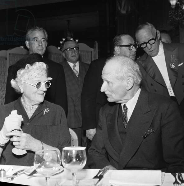Field Marshal the Viscount Montgomery of Alamein KG, GCB, DSO photographed with Lady Churchill GBE at a luncheon organised by Foyles Bookshop at the Dorchester Hotel. 31st October 1958 (b/w photo)