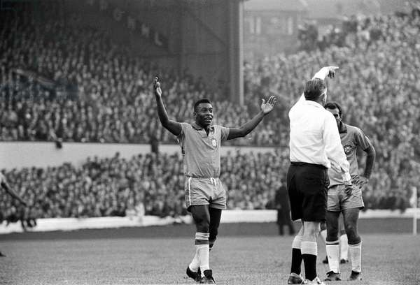 Pele July 1966 raises his hands as the referee awards a free kick in the Scotland v Brazil game in the 1966 at Hampden Park. y2k (photo)