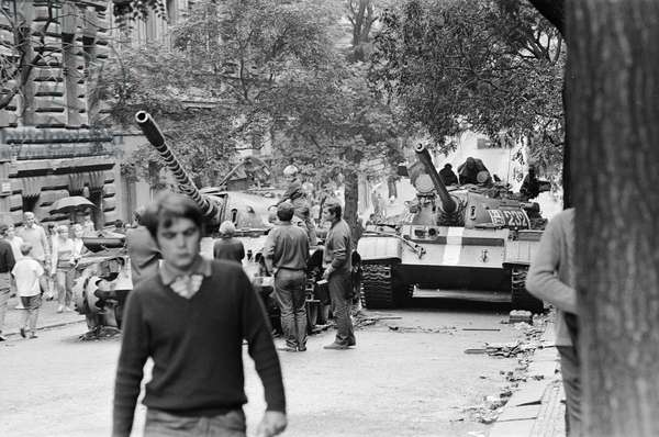 Czech children playing on a burnt out Russian tank at the end of the Prague Spring, August 1968 (b/w photo)