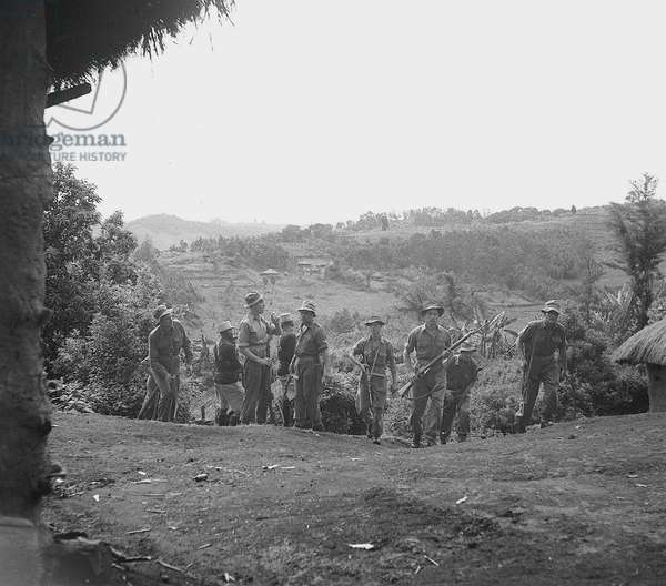 Men from the Lancashire Fusiliers, based up country at Fort Hall in the Kikuyu reserve on their first anti Mau-Mau patrol in a forest that the Kikuyu believe to be sacred, 1952 (b/w photo)