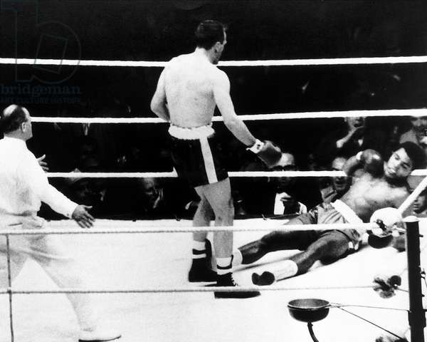 Muhammad Ali Cassius Clay Boxing Champion gets knocked own by Henry Cooper, 18th June 1963 (b/w photo)