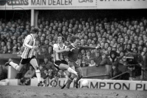 F. A. Cup. Southampton (1) vs. Chelsea (1). Peter Osgood is fouled by David Hay (Chelsea). January 1977 (photo)