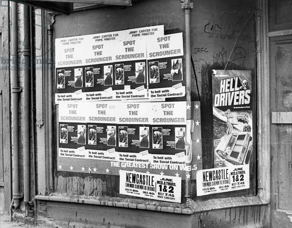 Anti Royalist poster in a shop window, Shield Road, Byker,  during the North East Leg of the Royal Jubilee Tour in 1977 (b/w photo)