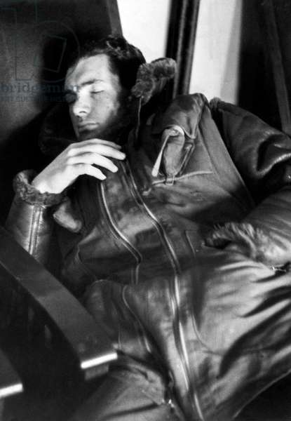 A pilot of the Royal Air Force caught up on some sleep between missions during the Battle of Britain in the Second World War, August 1940 (b/w photo)