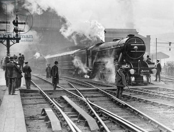 The Flying Scotsman steam train leaving Kings Cross station in London on its initial non stop run to Scotland, May 1928 (b/w photo)