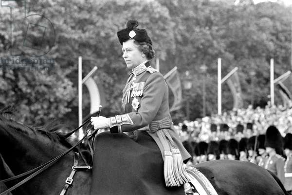 Her Majesty Queen Elizabeth II on horseback during the trooping celebration ceremony, June 1977 (b/w photo)