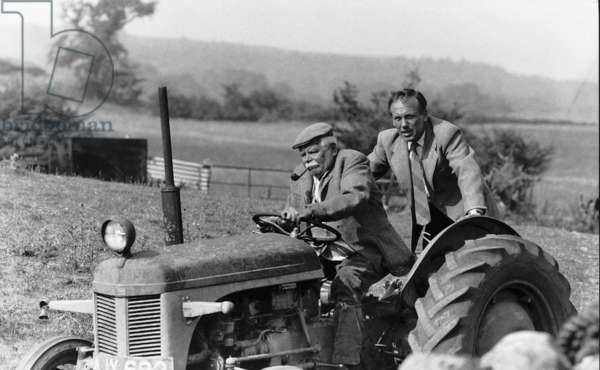 Graham Rigby actor driving the tracter and Christopher Timothy as James Herriot in the TV programme 'All Creatures Great and Small', August 1989 (b/w photo)