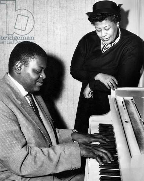 Ella Fitzgerald and Oscar Peterson, Jazz singer and piano specialists arrive in England for tour, February 1955 (b/w photo)