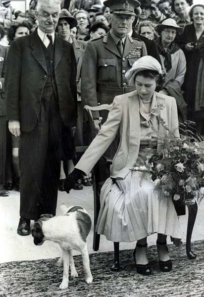 Princess Elizabeth at Sark receiving a bouquet of flowers, 1949 (b/w photo)