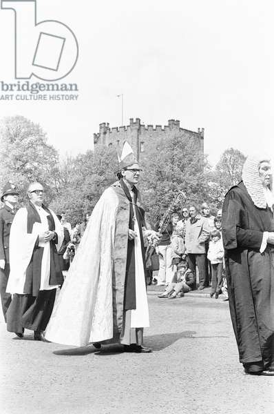 The Rt Revd Dr John Habgood the Bishop of Durham strikes the doors of the Cathedral with his staff. 20th May 1979 (b/w photo)