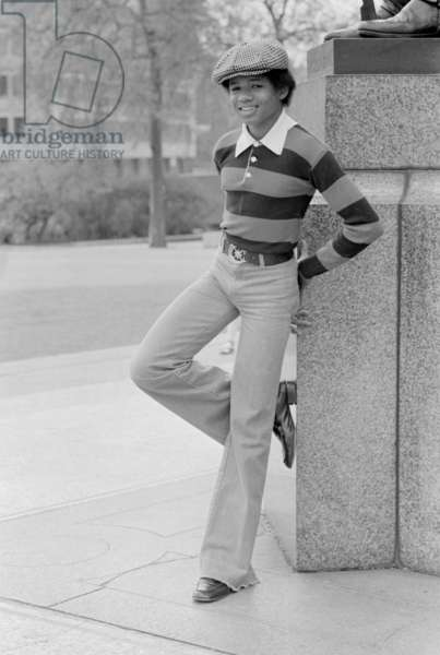 Randy Jackson of the Jackson Five pop group poses in Hyde Park, London, during their UK tour, 19th May 1977 (b/w photo)