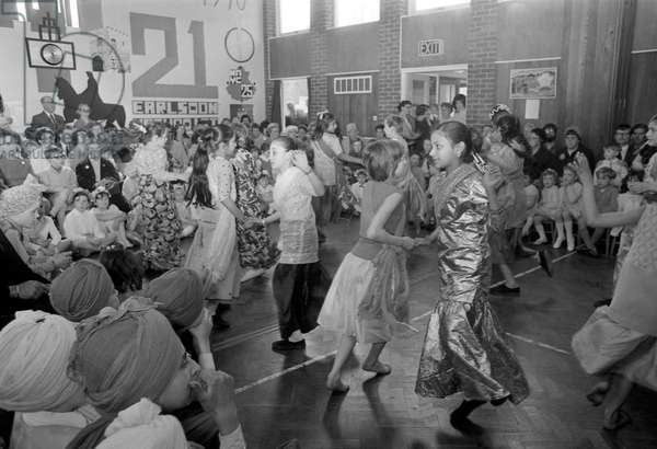 May Day celebrations took on an international flavour at the Earlsdon Methodist Church Hall, Coventry. Indian, West Indian, Pakistani, Irish and English children took part in an afternoon of dancing and music, 2nd May 1970 (b/w photo)