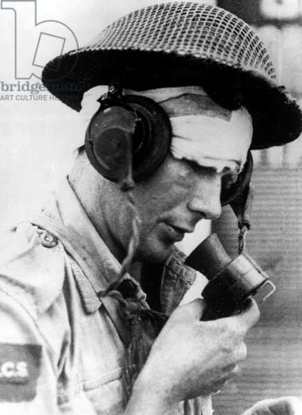 A wounded Canadian signalman speaking through a microphone in Reggio Calabria after the Allied invasion and liberation of Southern Italy September 1943 (b/w photo)