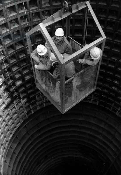 Descending the main shaft of the Channel Tunnel, Hertfordshire, UK, December 1987 (b/w photo)