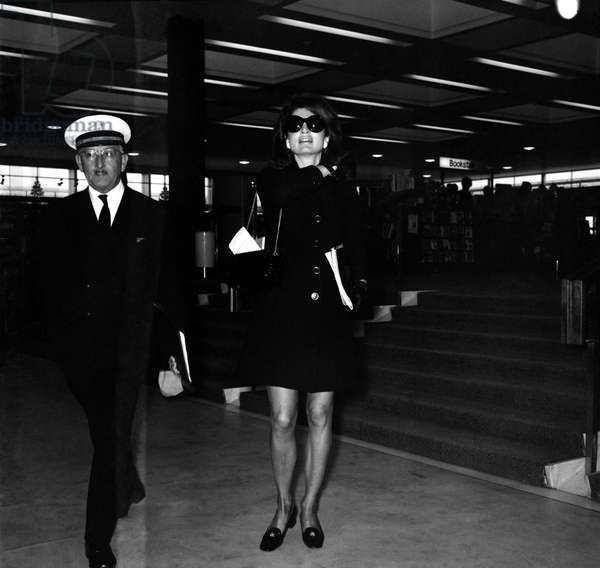 Mrs. Jacqueline Kennedy Onassis arrives at Heathrow Airport by Olympic Airways, on her way to the USA on Pan American Airways.