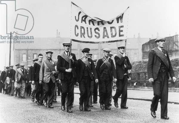 Unemployment Jarrow Marchers men in uniform carrying a banner reading 'Jarrow Crusade', 1930 (b/w photo)