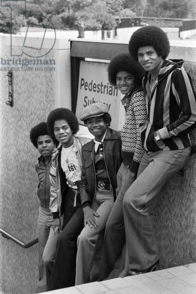The Jackson Five pop group pictured at Hyde Park Corner: they are Randy, 15, Michael, 18, Jackie, 26, Marlon, 20 and Tito, 23, 19th May 1977 (b/w photo)