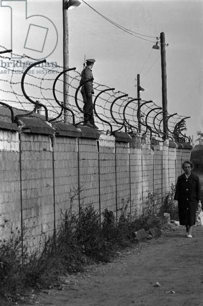Soldiers patrolling the Berlin Wall, October 1961 (b/w photo)