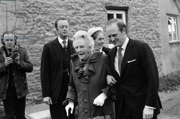 Churchill memorial service, at Bladon Church, Oxon. Lady Spencer-Churchill with her grandson Winston arriving at the church. 30th November 1974 (b/w photo)