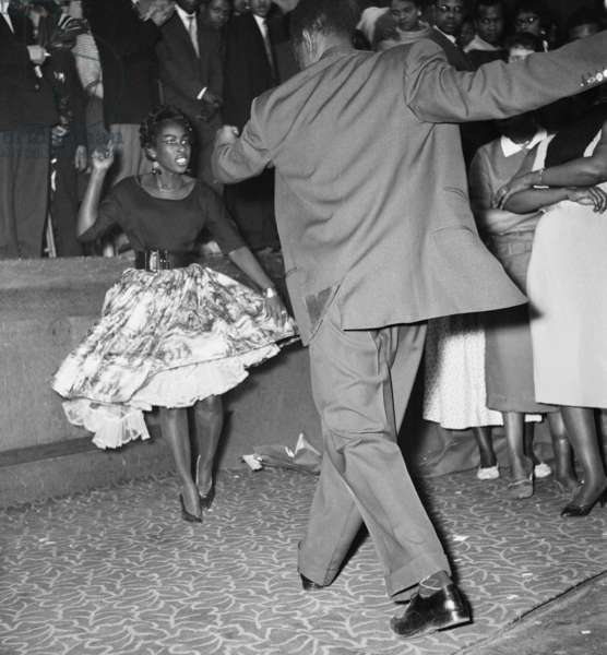Young couple dancing at the Notting Hill Carnival, 1959 (b/w photo)
