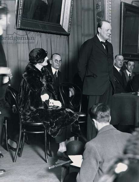 Winston Churchill photographed March 1924 addressing an election campaign meeting with him is Clementine Churchill (b/w photo)