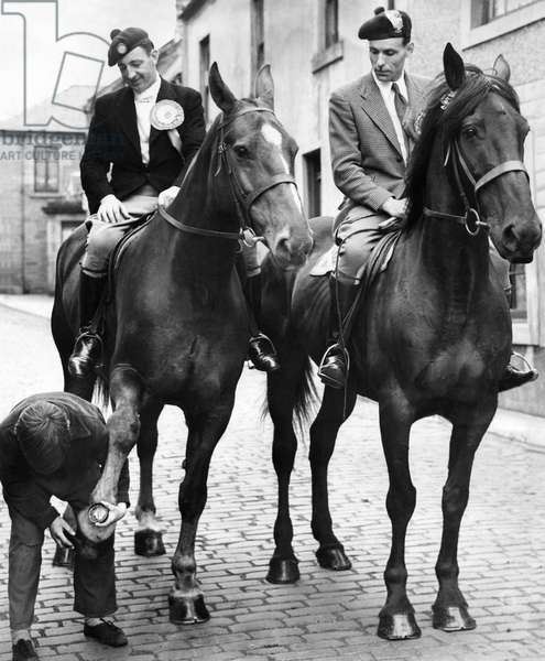 Men in costume riding on horseback during a commemoration of the Battle of Flodden field which took place in Northumberland in 1513, August 1952 (b/w photo)