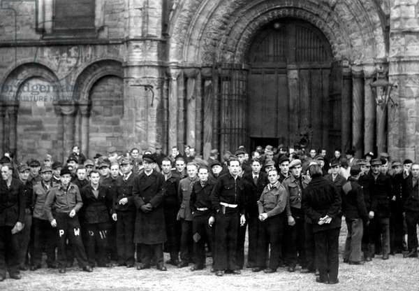 Over 1000 German prisoners of war (POW) attended a harvest thanksgiving service at Durham Cathedral on Sunday. It had been especially arranged for those who had worked on the farms in County Durham during the harvest. Sunday 27th October 1946 (b/w photo)