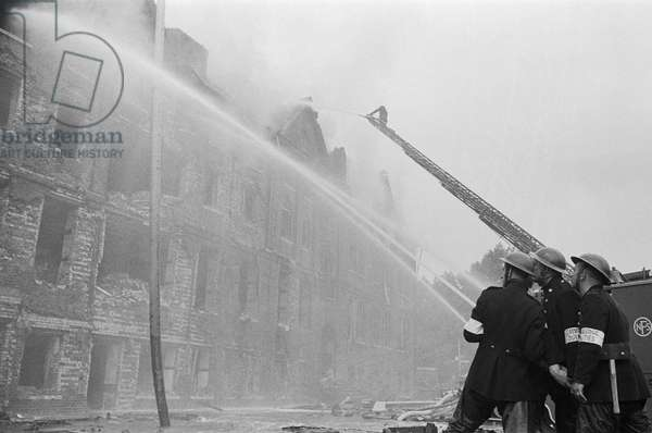 Firemen tackling a blaze during the Blitz (b/w photo)