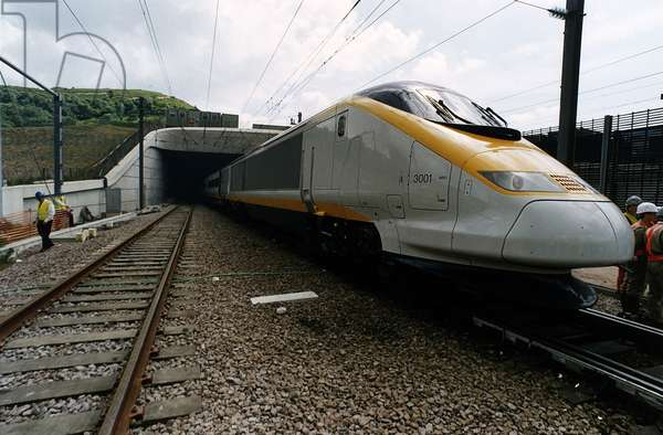 A Eurostar express train emerges from the mouth of the Channel Tunnel on a test run from Folkestone to Calais, 1993 (photo)