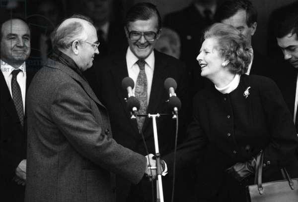 Prime Minister Thatcher shakes hands with Soviet Premier Gorbachev at RAF Brize Norton, December 1987 (b/w photo)
