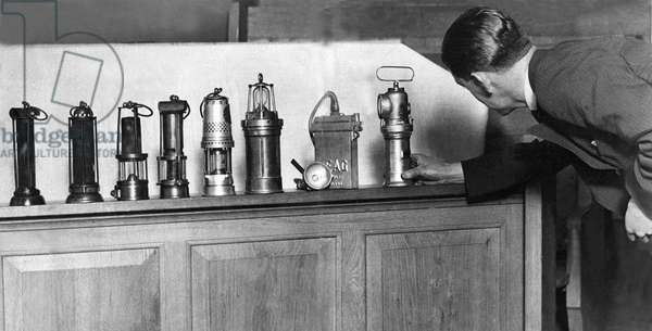The wonderful array of miners lamps, collected in Armstrong College, Newcastle. The earliest, The Davy and Stephenson lamps, are seen on the left, and each lamp along the line shows an improvement, with the most modern models on right.