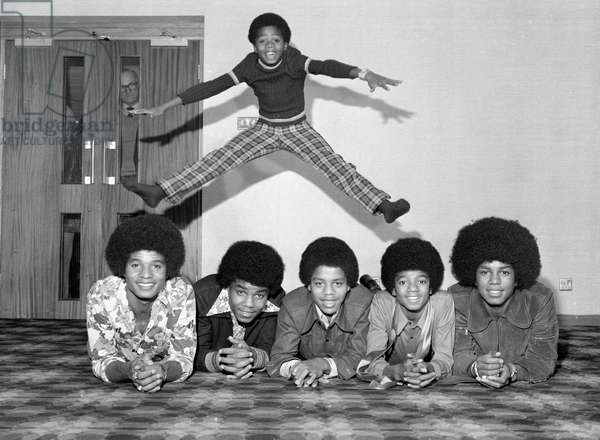 Members of the Jackson Five pop group become the Jackson Six when the latest addition to the family Randy Jackson joined the group, the group pictured left to right are: Jackie, tito, Marlon, Michael, Jermaine and little Randy jumping above all the lads, they are appearing in Manchester at the Kings Hall, Belle Vue, tonight, 10th November 1972 (b/w photo)