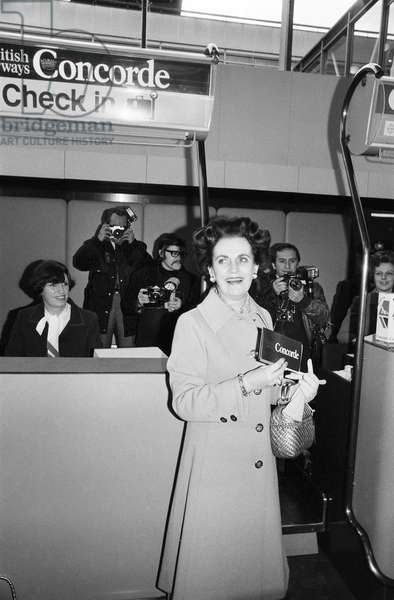 The Duchess of Argyle holding her ticket for the inaugural commercial flight of Concorde, Heathrow airport, London, 21st January 1976 (b/w photo)