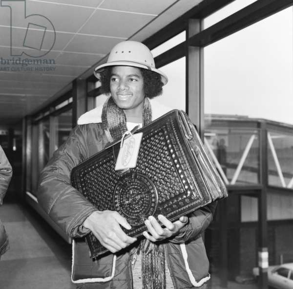 The Jackson Five pop group arrive in London for a UK tour, Michael Jackson holding his luggage as he makes his way through the arrivals hall, 