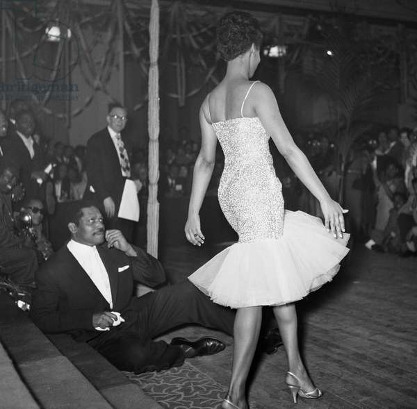 A dancer and band, Notting Hill Carnival, 1959