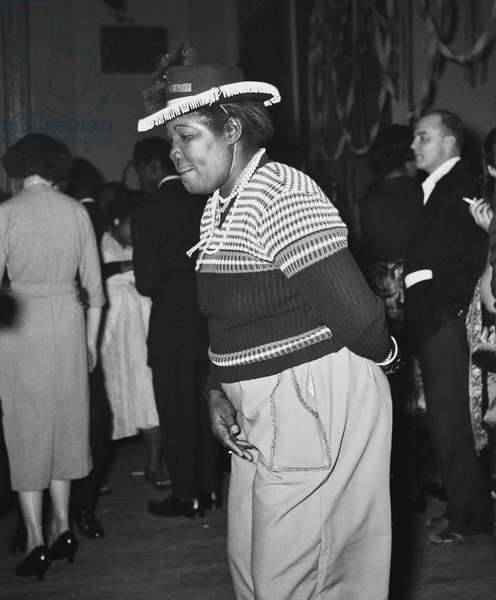 """The first ever """"Notting Hill carnival"""" was held indoors at St Pancras Town Hall, January 1959 (b/w photo)"""