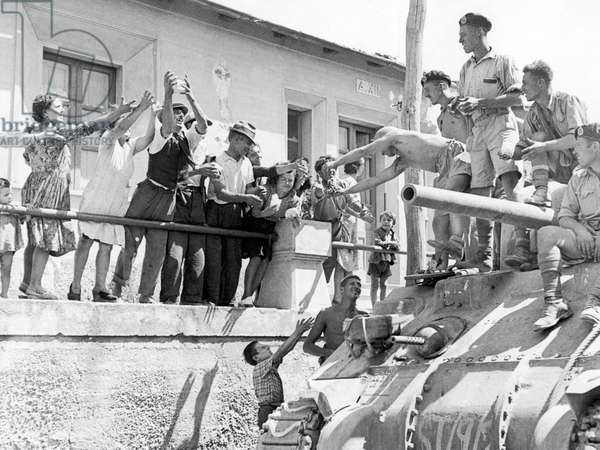 British soldiers greeted by local villagers during the Allied invasion and liberation of Italy September 1943 (b/w photo)