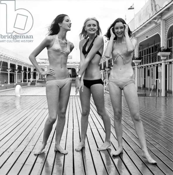 Three women modelling the latest in bikini fashions.. July 1970