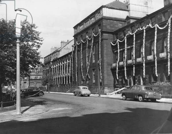 Queen Elizabeth II, Princess Elizabeth - Coronation - Highly decorated buildings in Eldon Square in Newcastle, 1950 (b/w photo)