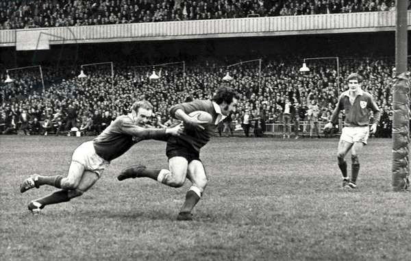 Gareth Edwards and Mike Gibson, during the Triple Crown Match at Cardiff Arms Park, 1971 (b/w photo)