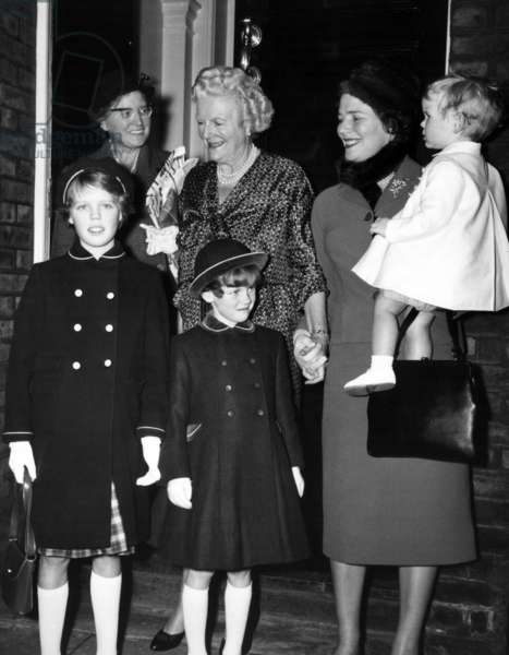 Lady Churchill with Mrs Mary Soames, and the Soames children, Rupert Christopher 1, Emma 9, and Charlotte 4. They were photographed during Sir Winston's birthday celebrations. November 1960 (b/w photo)