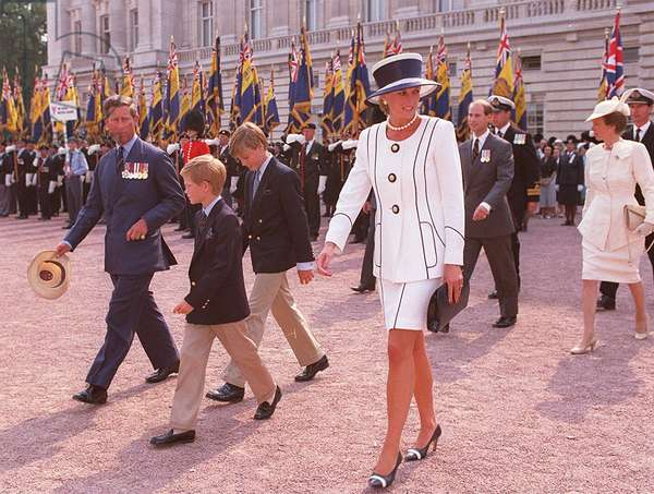 Prince Charles with Princess Diana and children Prince William and Prince Harry leave Buckingham Palace for service during celebrations on VJ day, August 1995 (photo)
