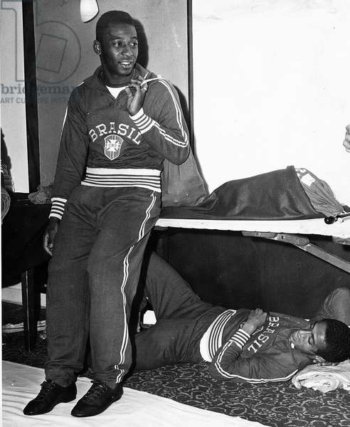 Pele Brazilian football player in team track suit with team mate Altair under the table 1966 (photo)
