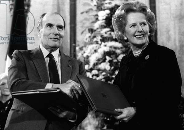 Prime Minister Thatcher with President Mitterand after signing the Channel Tunnel Agreement, 12th February 1986 (b/w photo)