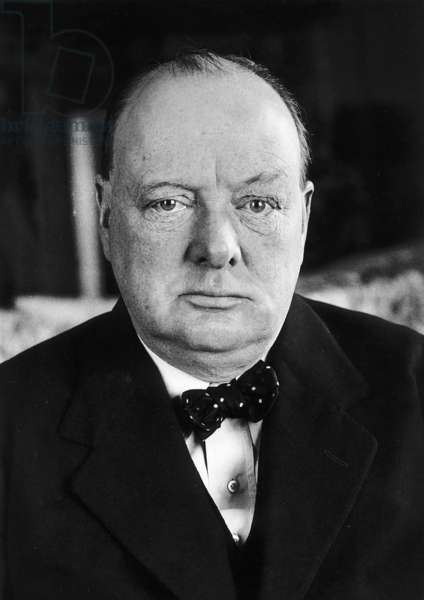 Winston Churchill wearing a jacket and spotted bow tie (b/w photo)